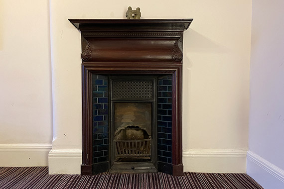 The Consulting room fireplace